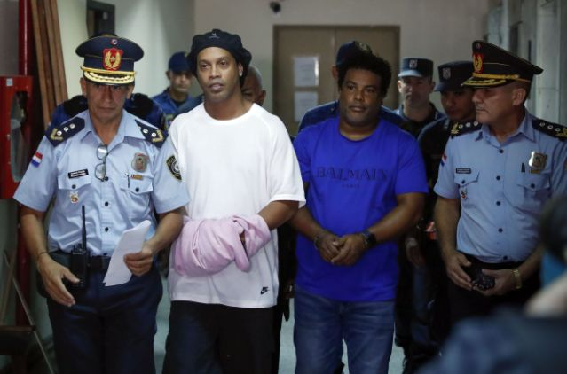 Football Legend, Ronaldinho And Brother Appear In Paraguayan Court In Handcuffs (Photos)